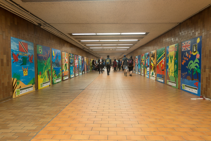 Over 60 paintings line the hallway of Spadina Station